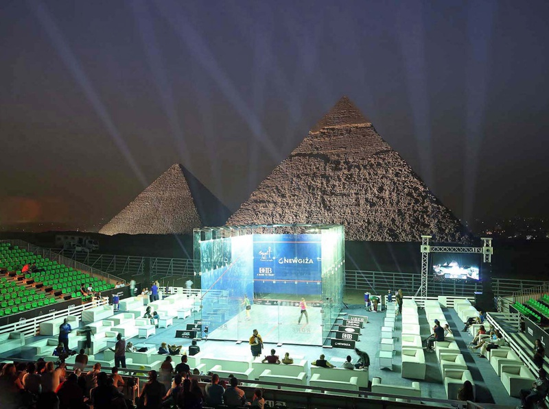 Court with pyramids in background